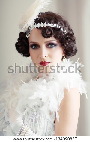 Beautiful young woman close up portrait in retro flapper style Vogue style vintage - stock photo