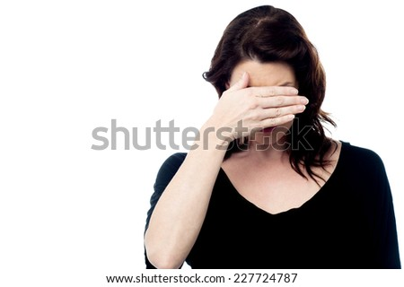 Beautiful young woman covering her face - stock photo