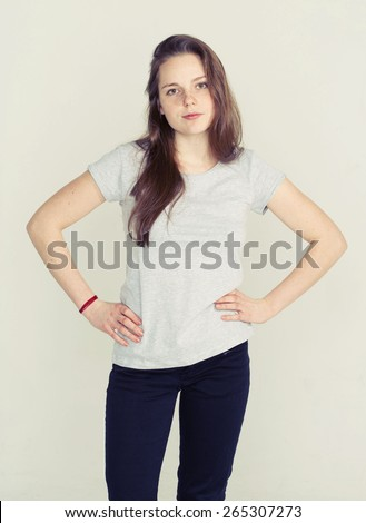 Beautiful young woman cute tender pure smiling isolated on white posing attractive hands on waist - stock photo