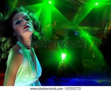 Beautiful young woman dancing in the nightclub - stock photo