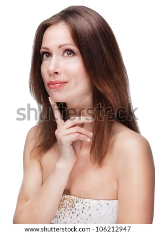 Beautiful young woman daydreaming over white background with finger on chin. Young woman is thinking with dreaminess on white background. Girl is coming in dreams - stock photo