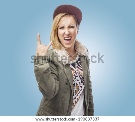 beautiful young woman doing the horn sign - stock photo