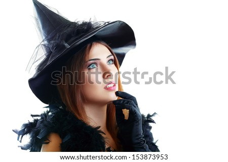 beautiful young woman dressed as a fairy or witch in fancy hat looking to the copyspace - stock photo