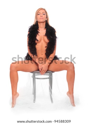 Beautiful young woman dressed in black boa. - stock photo