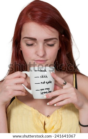 Beautiful young woman drinking coffee in the morning - stock photo