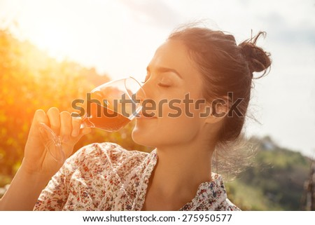 Beautiful Young Woman Drinking Wine In Vineyard - stock photo