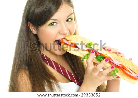 beautiful young woman eating a hot dog isolated against white background - stock photo