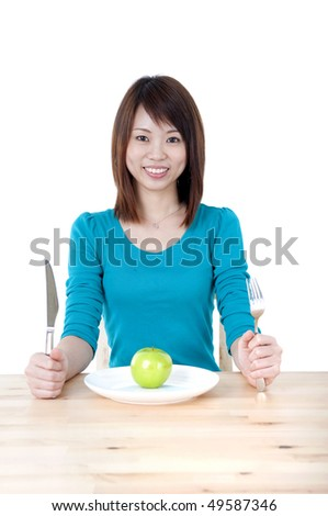 Beautiful young woman eating green apple. Isolated over white - stock photo