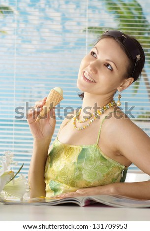 beautiful young woman eating ice-cream and enjoy your holiday - stock photo