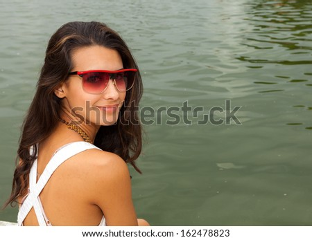 Beautiful young woman enjoying the fountains in Paris. - stock photo