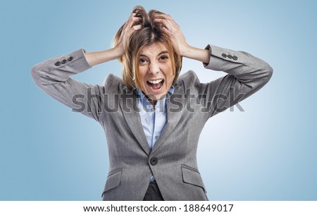 beautiful young woman executive desperate and screaming - stock photo