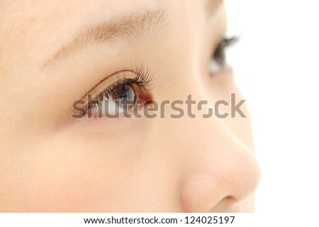 Beautiful young woman eyelash extension - stock photo