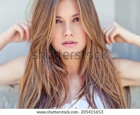 Beautiful young woman face closeup - stock photo