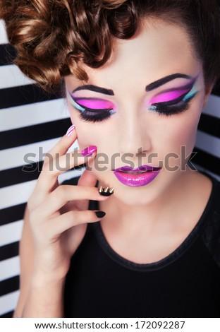 Beautiful young woman fashion make up and nail art - stock photo