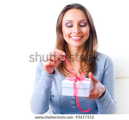 Beautiful Young Woman Getting Gift. Valentine's Day - stock photo