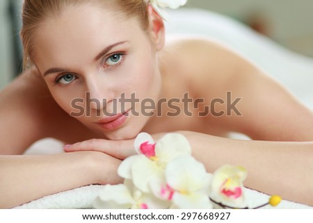 Beautiful young woman getting spa massage, lying on salon - stock photo