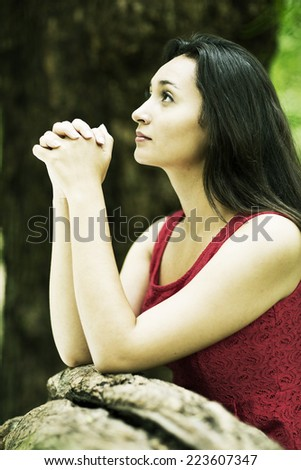 beautiful young woman hands praying in Outdoors - stock photo