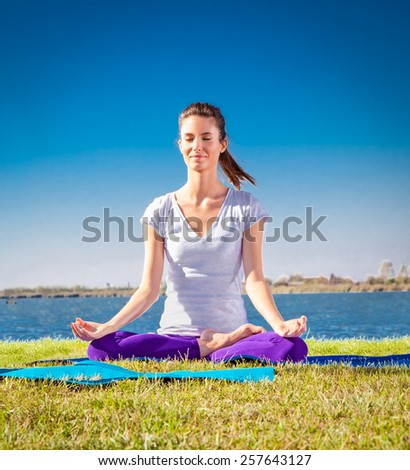 Beautiful young woman has a meditation on yoga class. Yoga concept. - stock photo