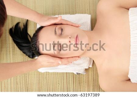 Beautiful young woman having massage - stock photo