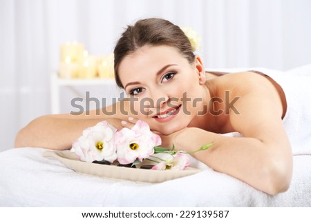 Beautiful young woman having relax in spa salon - stock photo