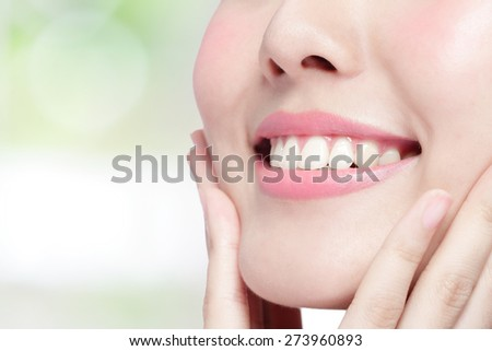 Beautiful young woman health teeth close up and charming smile. Isolated on green background, asian beauty - stock photo