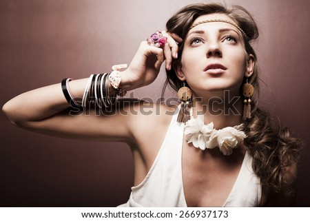 Beautiful young woman hippie on dark background - stock photo