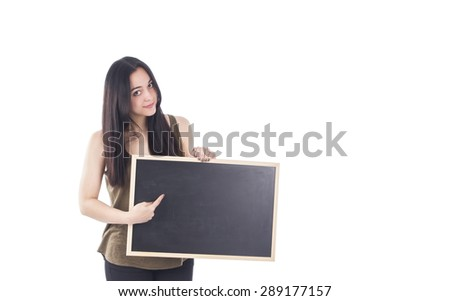 Beautiful young woman holding a blackboard against a white background - stock photo