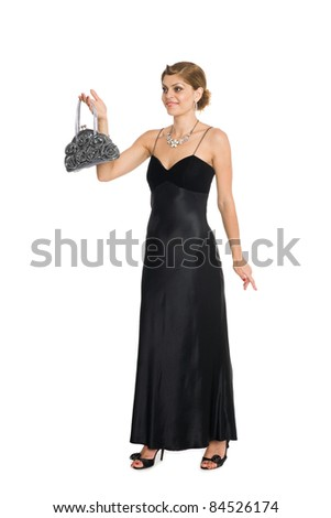 Beautiful young woman holding a handbag. - stock photo