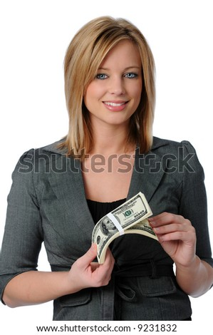 Beautiful young woman holding a stack of money isolated over white - stock photo