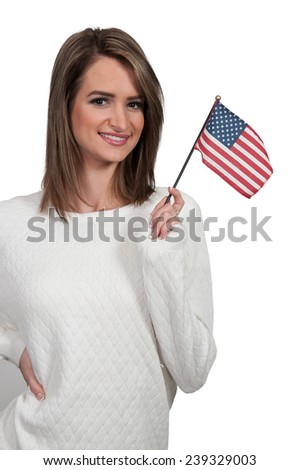 Beautiful young woman holding an American flag. - stock photo
