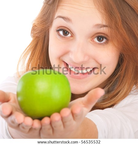 Beautiful young woman holding an apple, isolated on white background. - stock photo