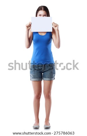 beautiful young woman holding blank sign card copy space advertisement in front of her face isolated on white - stock photo