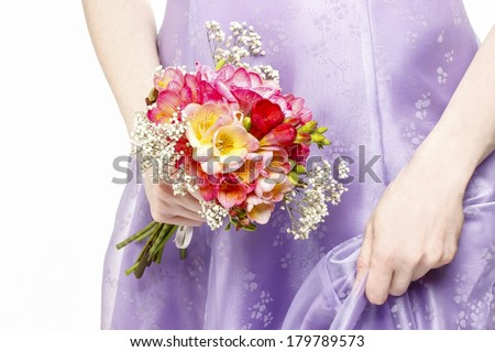 Beautiful young woman holding bouquet of flowers, isolated on white background - stock photo