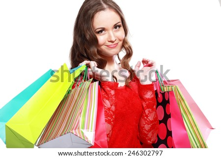beautiful young woman holding colored shopping bags - stock photo