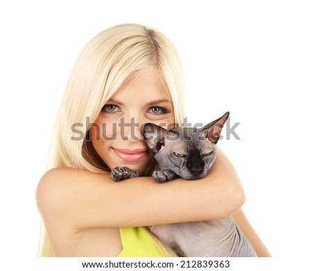 Beautiful young woman holding gray sphinx cat isolated on white - stock photo