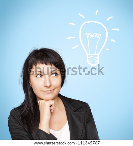 Beautiful young woman holding hand on chin, having brilliant idea. - stock photo
