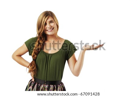 Beautiful Young Woman holding hand out - stock photo