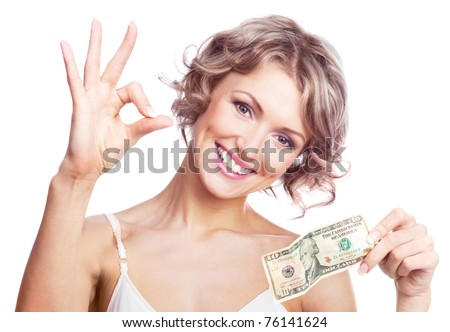 beautiful young  woman holding money and showing us the sign OK - stock photo