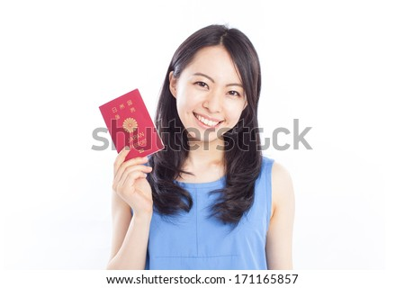 Beautiful young woman holding passport, isolated on white background - stock photo