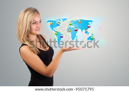 Beautiful Young woman holding virtual map - stock photo