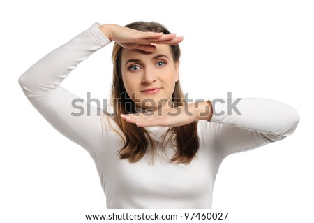 Beautiful young woman holds hands near head - stock photo