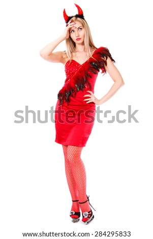 Beautiful young woman in a devil costume isolated over white background - stock photo