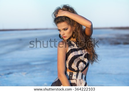 Beautiful young woman in a dress - stock photo