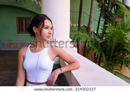 Beautiful young woman in a outdoor courtyard setting. - stock photo