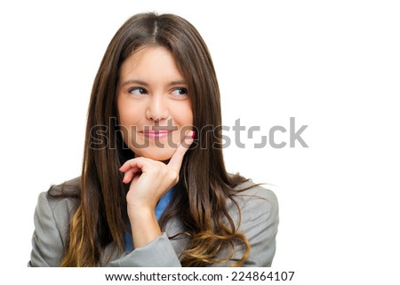Beautiful young woman in a pensive expression  - stock photo
