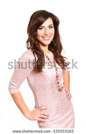 Beautiful young woman in a pink dress on white background - stock photo