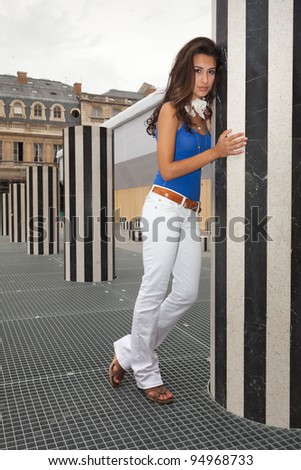Beautiful young woman in a plaza in Paris, France. - stock photo
