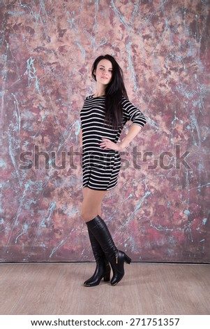 Beautiful young woman in a trendy shoes - stock photo