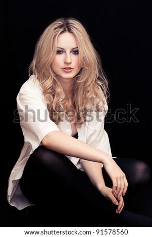 Beautiful young woman in a white man's shirt - stock photo