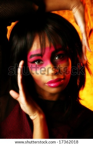 Beautiful young woman in artistic make up. - stock photo